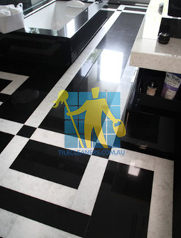 absolute black granite slab floor with white quartzite bands Jindalee