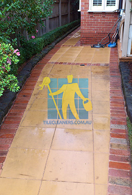 outdoor sandstone tiles pavers wet from cleaning with quarry tiles around Brisbane