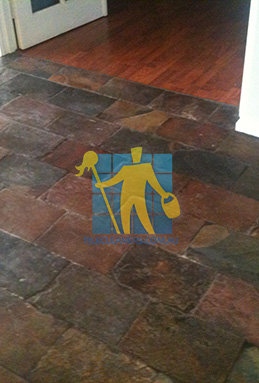dirty and dull looking slate tiles requires stripping and sealing Brisbane cleaning